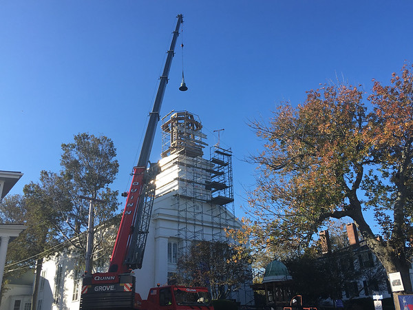 ABIGAIL BLISS/Staff photo/Salem-based American Steeple and Tower Company uses a crane to move First Congregational Church of Rockport's new bell from the lawn to the steeple's frame supports.