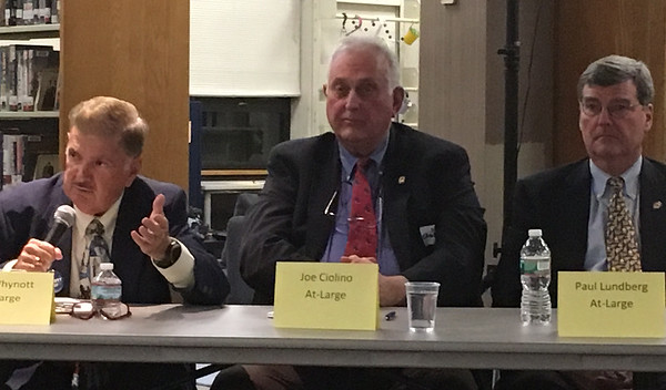 RAY LAMONT/Staff photo/At-large City Council candidate Bob Whynott answers a question while incumbents Joe Ciolino and Paul Lundberg wait their turn during Wednesday's debate at Sawyer Free Library.