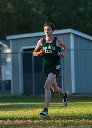 AMANDA SABGA/Staff photo. <br /> <br /> Manchester Essex's Matt Carter approaches the finish during a cross country meet between Manchester Essex and Hamilton-Wenham at Patton Park in Hamilton. <br /> <br /> 10/18/17