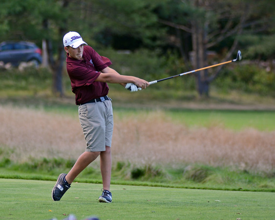 RYAN HUTTON/ Staff photo<br /> Rockport's Walker Knowles, 15, tees off at the ninth hole of the Essex Country Club during the Old Cape Ann Classic on Thursday.