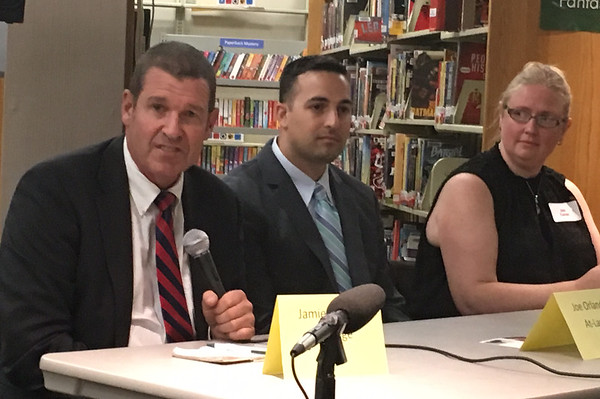 RAY LAMONT/Staff photo/At-large City Councilor Jamie O'Hara answers a question while fellow incumbent Joseph Orlando and challenger Jen Holmgren wait their turn during Wednesday's debate at Sawyer Free Library.