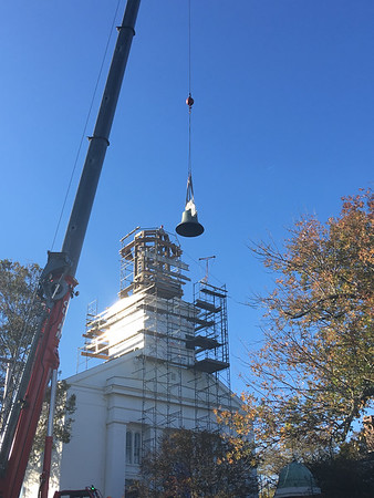 ABIGAIL BLISS/Staff photo/Workers with Salem-based American Steeple and Tower Company use a crane to move First Congregational Church of Rockport's new bell onto the steeple's frame supports.