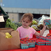 RYAN HUTTON/ Staff photo<br /> Isabella Roberts, 6, helps her grandmother Rosa Siragusa, both of Gloucester, pick out some berries at Farmer Dave's stand at the Cape Ann Farmer's Market at Stage Fort Park in Gloucester on Thursday.
