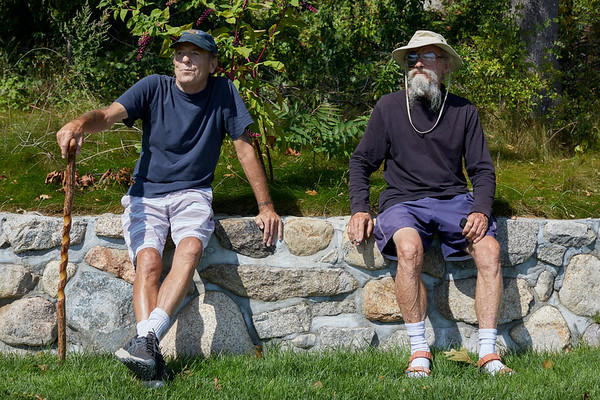 (L-R) Paul Belliveau & Chris Boland watch the parade of Schooner ships in Gloucester, Sunday, September 2, 2018. Jared Charney / Photo