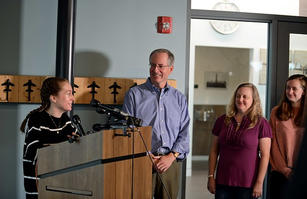 RYAN HUTTON/ Staff photo<br /> Student pilot Maggie Taraska, 17, left, speaks at a news conference at the Beverly Airport on Monday after she she made a successful emergency landing on Sunday when one of her plane's wheels fell off during takeoff. From left are her dad Walter, mother Christine and sister Ellie. [[MER1809101649501519]]