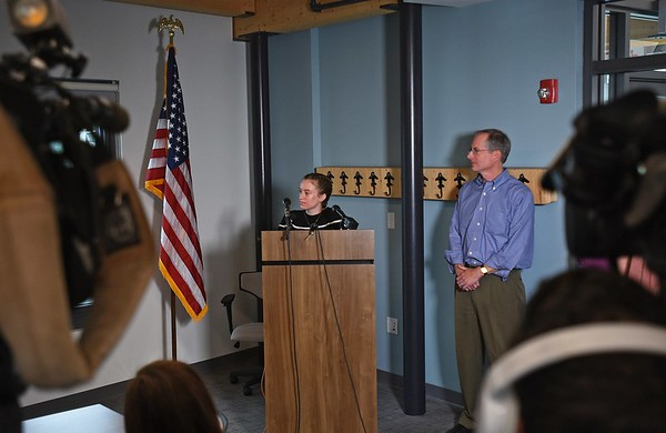 RYAN HUTTON/ Staff photo Student pilot Maggie Taraska, 17, left, speaks at a news conference at the Beverly Airport on Monday after she she made a successful emergency landing on Sunday when one of her plane's wheels fell off during takeoff. At right is her dad Walter. [[MER1809101650031523]]