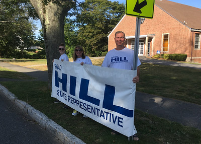 ANDREA HOLBROOK/Staff photo/State Rep. Brad Hill, R-Ipswich, was campaigning around 9 a.m. Tuesday at the Rowley polls at St. Mary Church on Main Street with wife Aimee and daughter Courteny. The incumbent for 4th Essex District said they had been in town for about an hour and were going to stay a little longer before heading to polls in Manchester, Ipswich, and other towns and his district. While unopposed in the primary, Hill will face Democrat Allison Gustavson of Manchester in September.