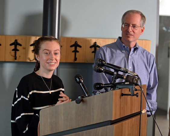 RYAN HUTTON/ Staff photo<br /> Student pilot Maggie Taraska, 17, left, speaks at a news conference at the Beverly Airport on Monday after she she made a successful emergency landing on Sunday when one of her plane's wheels fell off during takeoff. At right is her dad Walter. [[MER1809101650081525]]