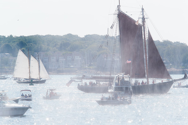 Schooner ships veiled in smoke created by cannons in Gloucester, Sunday, September 2, 2018. Jared Charney / Photo