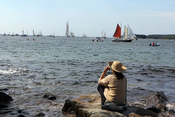 AMY SWEENEY/Staff photo.<br /> Laura Colbourn, of Topsfield, watches the Parade of Sail from Stacy Boulevard while her husband kayaked to get a closer view of the schooners during the 33rd annual Gloucester Schooner Festival.<br /> Sept. 4, 2017