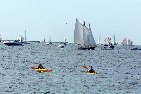 AMY SWEENEY/Staff photo.<br /> Kayakers get a closer view of the Parade of Sail during the 33rd annual Schooner Festival.<br /> Sept. 4, 2017