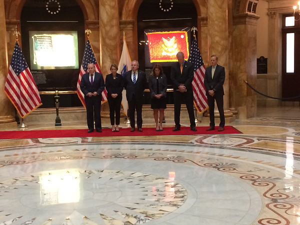 CHRISTIAN M. WADE/Staff photo<br /> Gov. Charlie Baker, Attorney General Maura Healey and other top elected leaders held a moment at silence at the Massachusetts Statehouse on Monday to honor those killed and wounded in the Las Vegas shooting.