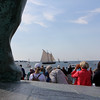 AMY SWEEENEY/Staff photo. Crowds line up on Stacy Boulevard as the schooners proceed from the Inner Harbor past the Fishermen's Memorial Statue to watch the Parade of Sail of the Gloucester Schooner Festival.<br /> Sept. 4, 2017.
