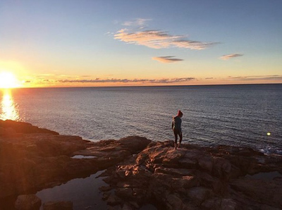 TAYLOR BRADFORD/Staff photo/An early riser catches the sunrise at Rafe's Chasm off Hesperus Avenue in Gloucester.
