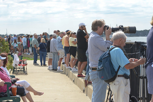Gloucester:  Spectators gather in the park at Fort Square to photograph, video tape and watch the schooners as they parade out into Gloucester Harbor Sunday morning.  Desi Smith/Gloucester Daily Times. September 2, 2012