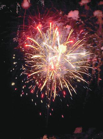 Gloucester: Fireworks burst over Gloucester Harbor Saturday night.  Desi Smith/Gloucester Daily Times. September1, 2012