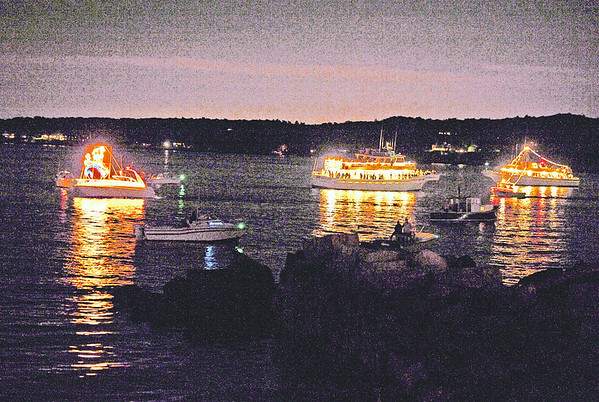 Gloucester: Whale Watch and pleasure boats sit in the harbor to veiw the Parade of Lights and the Fireworks that followed Saturday night.  Desi Smith/Gloucester Daily Times. September 1, 2012