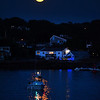 Gloucester: A full moon rises before the start of Parade of Lights Saturday night in Gloucester Harbor.  Desi Smith/Gloucester Daily Times. September 1, 2012