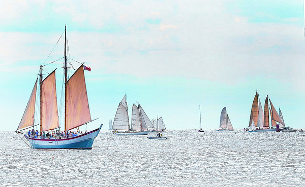 Gloucester:   The Schooner Ardelle left, sails in open waters along with other Schooners in the Parade of Sails Sunday morning off Eastern Point. Desi Smith/Gloucester Daily Times. September 2, 2012