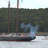 Gloucester:  The Schooner Adventure who lead the Parade of Sails into Gloucester Harbor, fires of a cannon round for spectators along Stacey Boulevard Sunday morning.  Desi Smith/Gloucester Daily Times. September 2, 2012