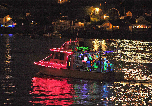 Gloucester: The GloBoat made its way through the harbor in the Parade of Lights Saturday night.  Desi Smith/Gloucester Daily Times. September 1, 2012