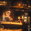 Gloucester: Spectators gathered on their decks and front lawns on Rocky Neck to veiw the Parade of Lights and the Fireworks that followed Saturday night.  Desi Smith/Gloucester Daily Times. September 1, 2012