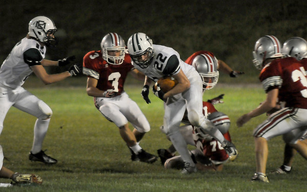 Amesbury: Manchester Essex's John Beardsley looks for yardage during the Hornet's game at Amesbury Friday night. Jim Vaiknoras/staff photo