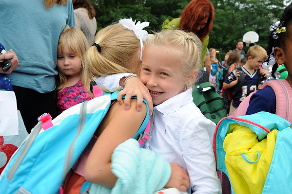 Gloucester:  Friends Abigail Lowthers (left) 6, and Ariana Mullen 6, were happy to see each other on their first day back at West Parish School Wednesday morning. For some other children, a not so happy first day.  Desi Smith/Gloucester Daily Times. September 5, 2012