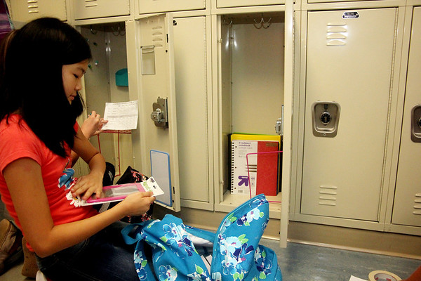 Allegra Boverman/Gloucester Daily Times On the first day of school Thursday, Manchester-Essex Middle School sixth grader Rebecca Shan unpacks her new school supplies into her new locker and also unwraps her new magnetic locker mirror.
