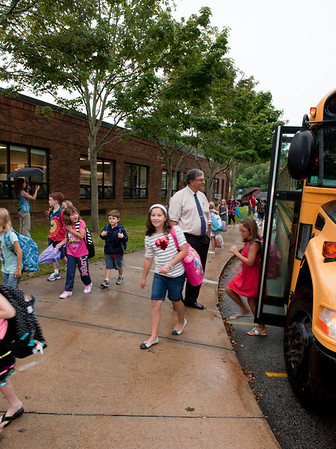 Rockport: New superintendent of school Rob Liebow, greets students as they exit the buses at Rockport Elementary School on their first day of school Tuesday morning. Desi Smith/Gloucester Daily Times. August 28,2012