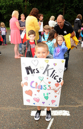Gloucester: Marty Behsman 6, holds up a sign showing other students where the line is for Mrs Klics first grade class is, on the first day of school at West Parish Wednesday morning. For some other children, a not so happy first day.  Desi Smith/Gloucester Daily Times. September 5, 2012