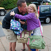 Rockport:  Twins Breanna and Isabella 11, give dad Daryl a group hug just before they enter the elementary school on their first day of school Tuesday morning. Desi Smith/Gloucester Daily Times. August 28,2012