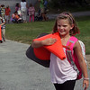 Allegra Boverman/Gloucester Daily Times On the first day of school Thursday at Essex Elementary School, Peyton Falk, a third grader, front, and her brother Charlie Falk, a first grader, behind her, were enlisted by the principal to bring the cones inside that marked where the student pickup area was after school. They were waiting for their mom to pick them up.