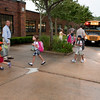 Rockport: Principal Shawn Maguire left, and new superintendent of school Rob Liebow on right, greet students as they exit the buses at Rockport Elementary School on their first day of school Tuesday morning. Desi Smith/Gloucester Daily Times. August 28,2012