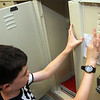 Allegra Boverman/Gloucester Daily Times On the first day of school Thursday at Manchester-Essex Middle School, Ben Soulard gets his locker set up and taped his new schedule to the inside of the door.