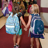 Rockport:   These friends hold hands as they enter the elementary school on their first day of school Tuesday morning. Desi Smith/Gloucester Daily Times. August 28,2012