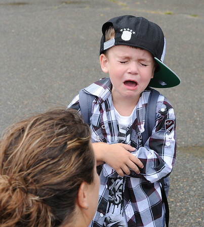 Gloucester:  I don't wanta go!  This little boy had a hard time leaving mom on his first day at West Parish School Wednesday morning.  Desi Smith/Gloucester Daily Times. September 5, 2012