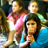 Allegra Boverman/Gloucester Daily Times. During the final assembly at the Gloucester Community Arts Charter School on Wednesday morning. From left, sisters Marisa and Lucia Dimeo, fourth and sixth graders, respectively, listen to their classmates as they shared their favorite memories from being a student at the school.