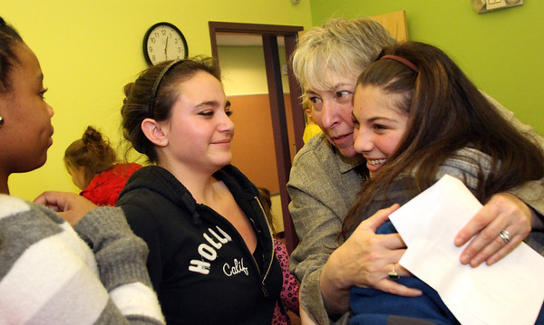Allegra Boverman/Gloucester Daily Times. During the final assembly at the Gloucester Community Arts Charter School on Wednesday morning. From left are eighth graders Samantha Charles, Mollie-Mae Macgillavray, and Michelle Puccio with principal Beth Delforge.
