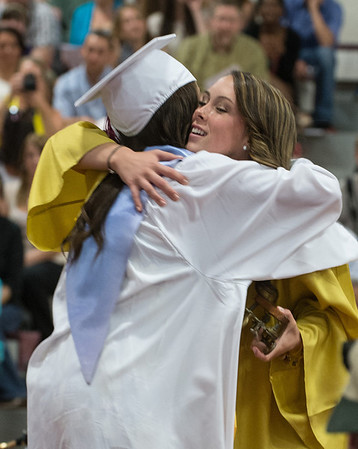 Desi Smith/Gloucester Daily Times. Abigail Avila transfers Leadership to Olivia Parsons of the Class of 2014 at the graduation of GHS Class of 2013 Sunday afternoon in the Benjamin A Smith Fieldhouse.      June 9,2013