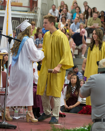 Desi Smith/Gloucester Daily Times.Class President Erin Jermyn transfers Leadership to Kevin Rogers, the Class of 2014 as Olivia Parsons also the Class of 2014 waits for her transfer, at the graduation of GHS Class of 2013 Sunday afternoon in the Benjamin A Smith Fieldhouse.      June 9,2013