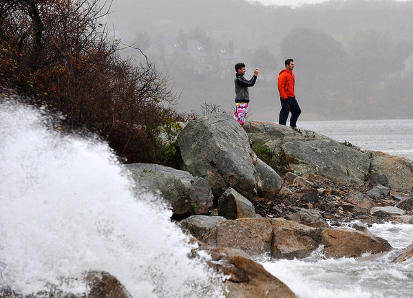Gloucester:  Jack McGraw takes some photo's of the surf from Good Harbor Beach as friend Kyle Lightner watches. Both men are from Andover,Mass and came to Gloucester for Storm Sandy. Desi Smith/Gloucester Daily Times. October 29,2012.