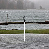 Allegra Boverman/Gloucester Daily Times. The view of the high water from the Essex River at The Essex River House Motel's property on Monday during the hurricane.