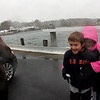 Allegra Boverman/Gloucester Daily Times. The Altieri family of Essex came to look at the high water along the Essex River in downtown Essex at the causeway on Monday during the hurricane. From left are mom Nadine, and A.J., 7, and his sister Hailey, 9.