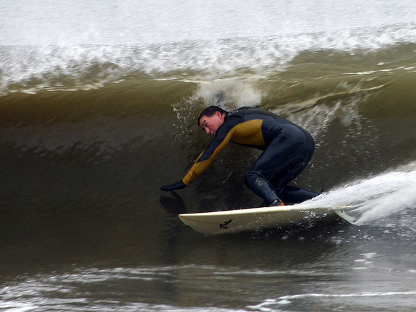 Photo courtesy of Rob Bibelhauser. William Lawthor of Lanesville navigates a wave's barrel on Magnolia Beach on Monday during the hurricane weather conditions.