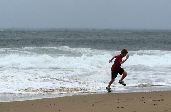 MIKE SPRINGER/Gloucester Daily Times<br /> John Makowski, 12, of Manchester runs back to keep ahead of the advancing tide late Monday morning at Singing Beach in Manchester.