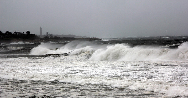Allegra Boverman/Gloucester Daily Times. High surf along Cape Hedge Beach in Rockport on Monday during the hurricane, with Thatcher Island and one of the Twin Lights in the background.