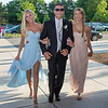 Desi Smith/Gloucester Daily Times.   A happy Jonathan Ferrante proudly escorts Caroline Stankus and Aisling Batchelder into Manchester Essex Regional High School on Saturday evening before heading off to prom night.   June 1,2013