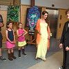 Desi Smith/Gloucester Daily Times.  Dylan McClure, at right, gets a look of approval from his date Julia Whitten, her sisters Jane, 8, Anna, 9, and their dad when he met them at Manchester Essex Regional High School on Saturday evening for prom night.   June 1,2013