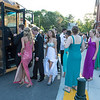 Desi Smith/Gloucester Daily Times.   Prom goers board school buses at Manchester Essex Regional High School on Saturday evening on their way out of town for prom night. Traditionally MERHS prom photos take place at Tucks Point, but because of a wedding taking place there and prom bring pushed back from Friday to Saturday due to SAT tests, the students couldn't go to Tucks Point this year.    June 1,2013